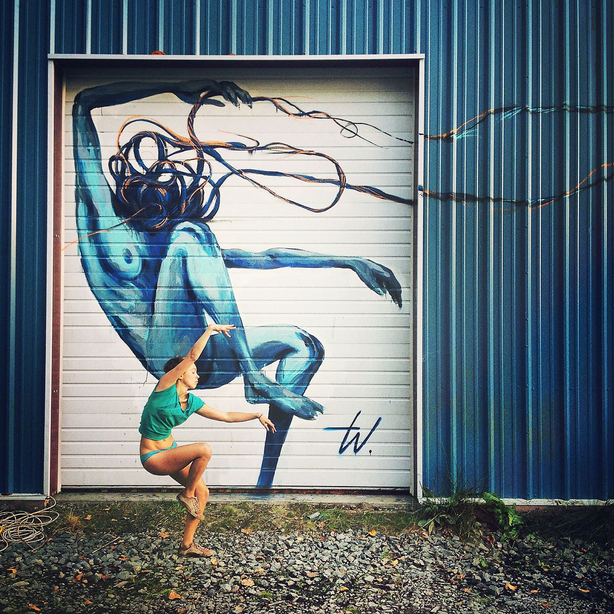 Taylor White live mural painted over the course of Sh'bang, leaving her mark in the form of a permanent mural painted on the side of our warehouse dance studio. Photo by Eric Parthum, Dancer Drea Lusion.