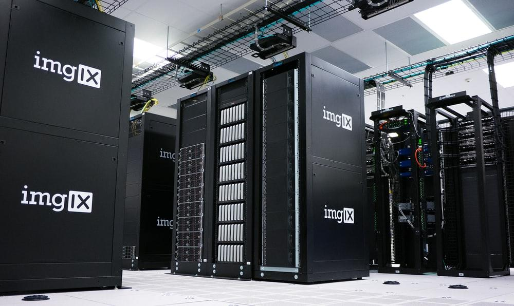 img IX mining rig inside white and gray room
