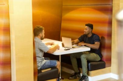 Two men using talent marketing technology