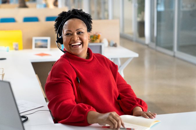 A happy customer service agent at a storage company