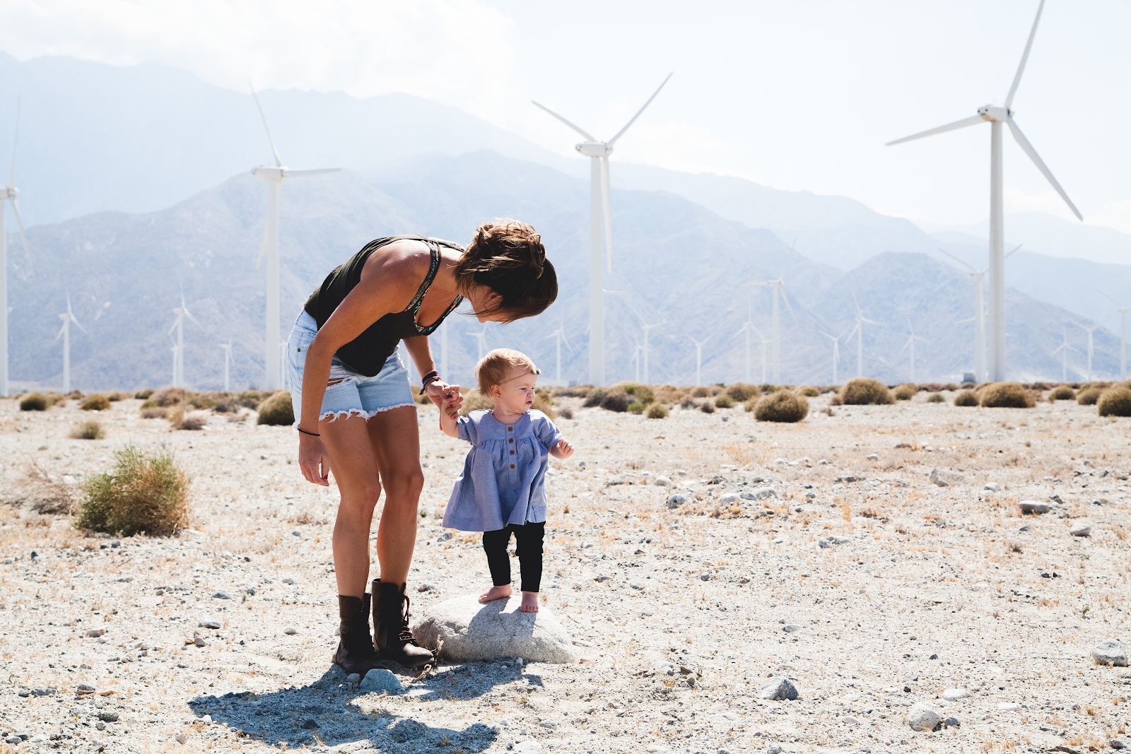 mother and child in wind farm