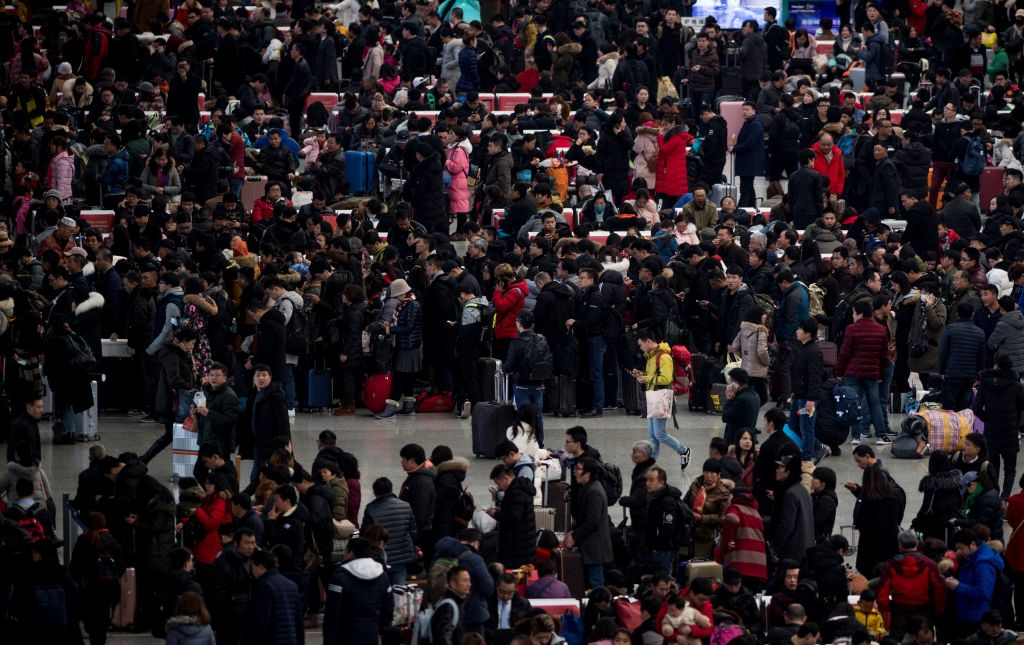 Passengers gather in the waiting hall at Hongqiao Railway Station ahead of the Lunar New Year holidays in Shanghai on February 6, 2018. China may be looking at losing its title of the world's largest population to India as the nation, plagued by the long-term impact of negative Communist Party social policies, suffers an ever worsening population crisis.
