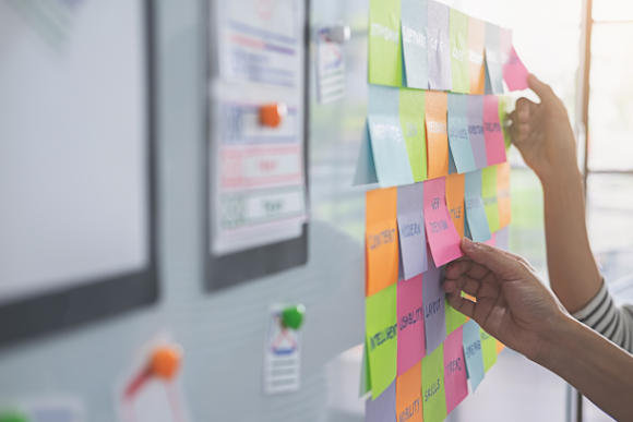 UX vs UI: Colorful sticky notes on bulletin board