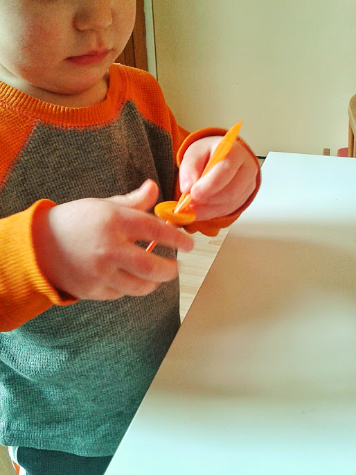 Welcome to Mommyhood: feathers and buttons fine motor activity