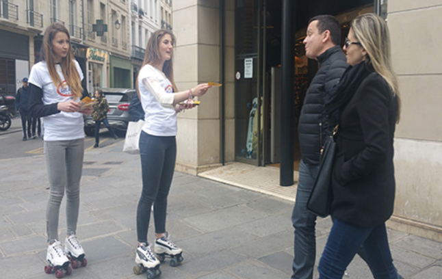 A group of people standing outside a building  Description automatically generated with low confidence