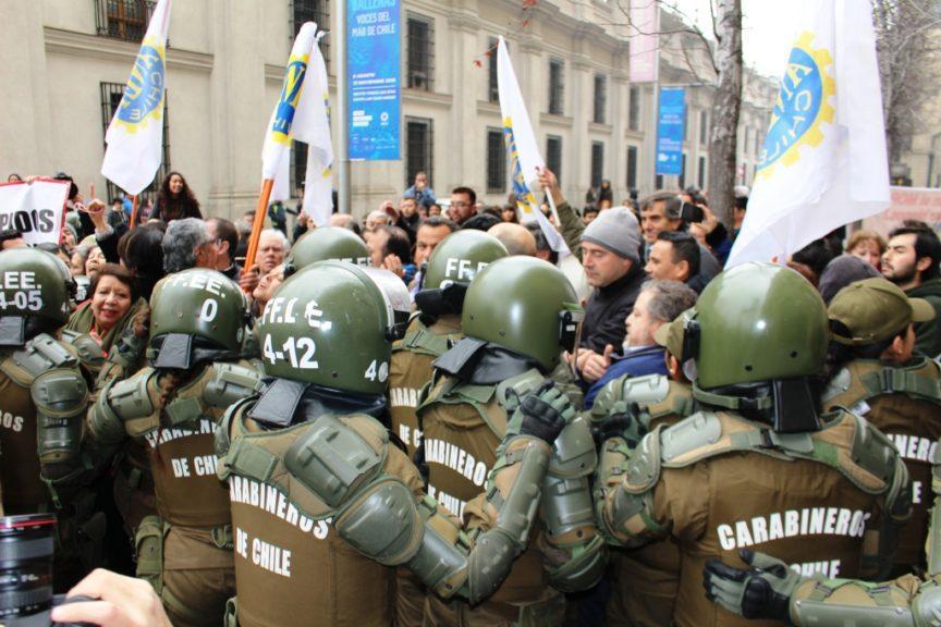 Police contain a protest in Chile
