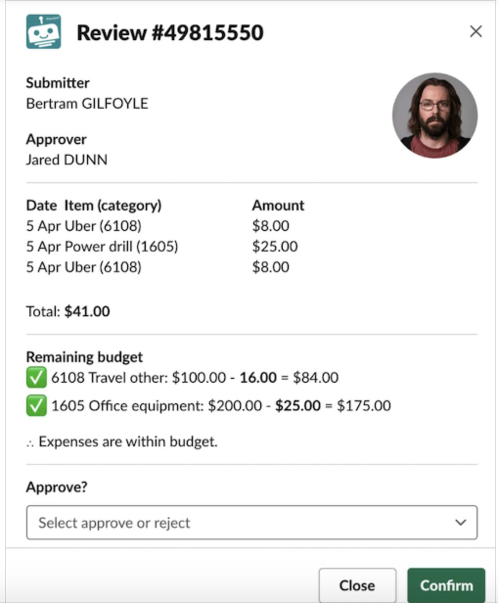 A chatbot message that asks an employee to approve or reject an expense request