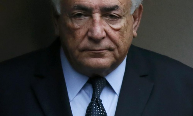 Dominique Strauss-Kahn leaves his hotel to attend the trial.