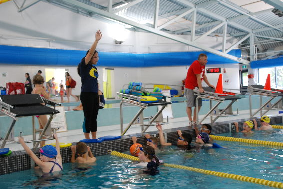 Coaches Leila and Kevin working with New and returning Blue Novatech swimmers