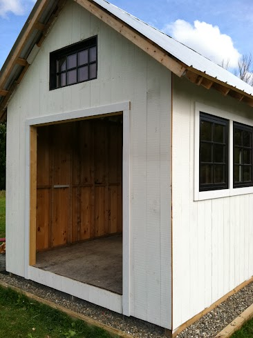 White Shed. Black windows. Soon gray interior.