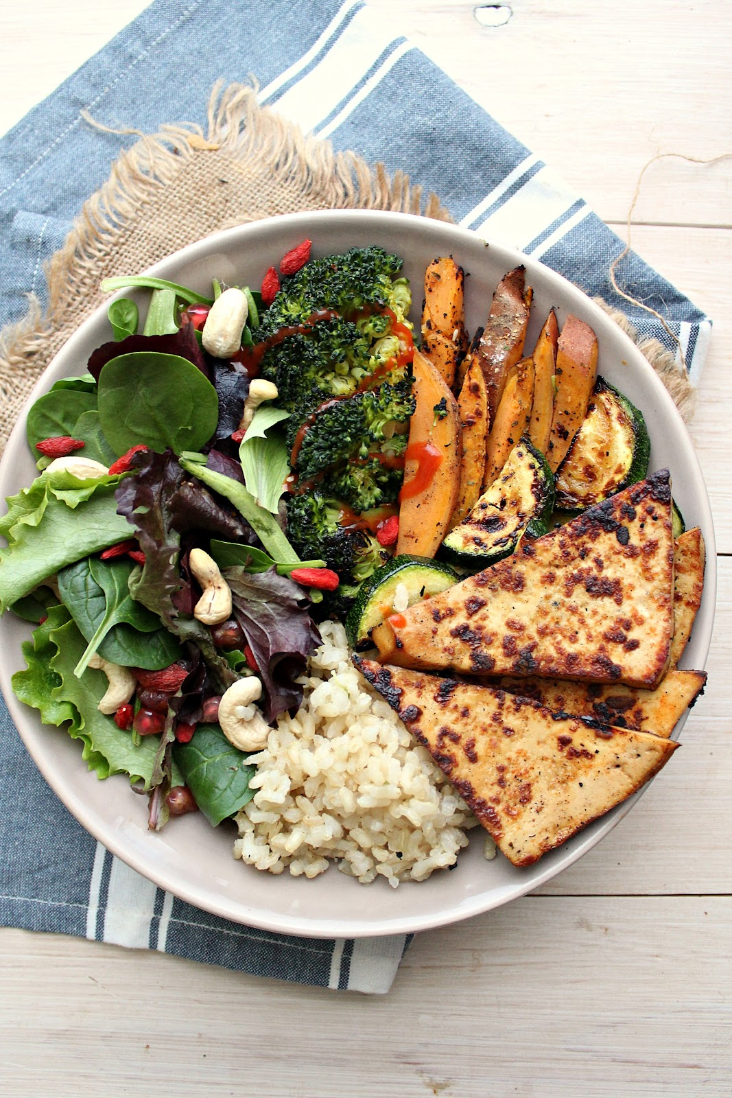 "4 Ingredient ""Crack"" Tofu + Abundance Bowl - this tofu recipe is made in minutes, with minimal mess. Crispy on the outside, tender on the center, sweet and spicy and utterly delicious! You need to try this!"