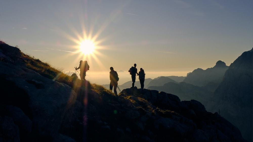 four person on mountain during daytime