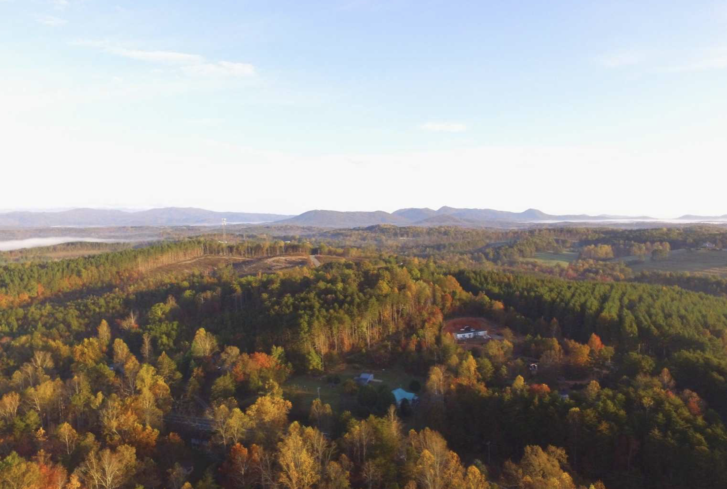 aerial view of campground in the fall with mountains in distance