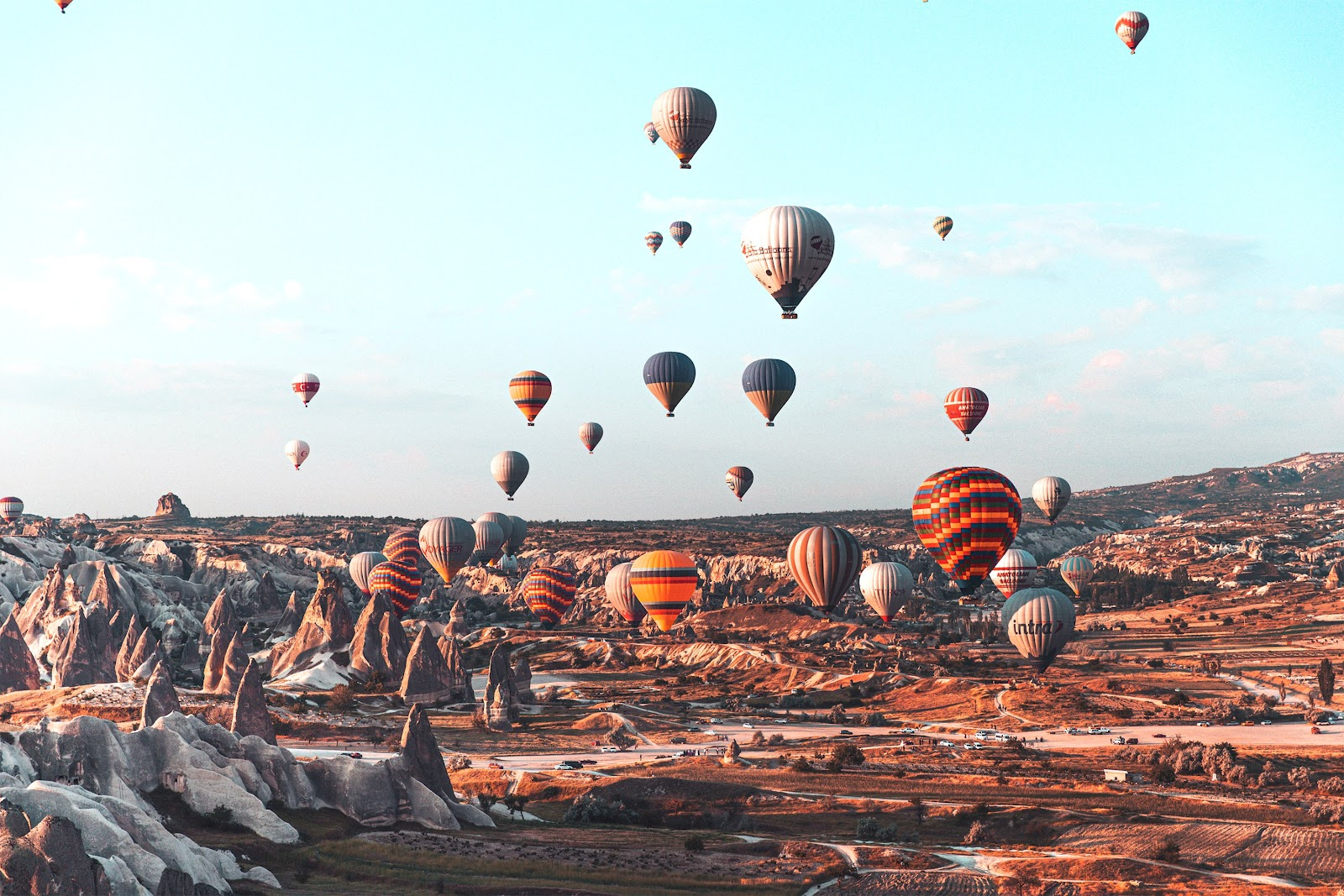Hot air balloons rising over the mountains of Turkey