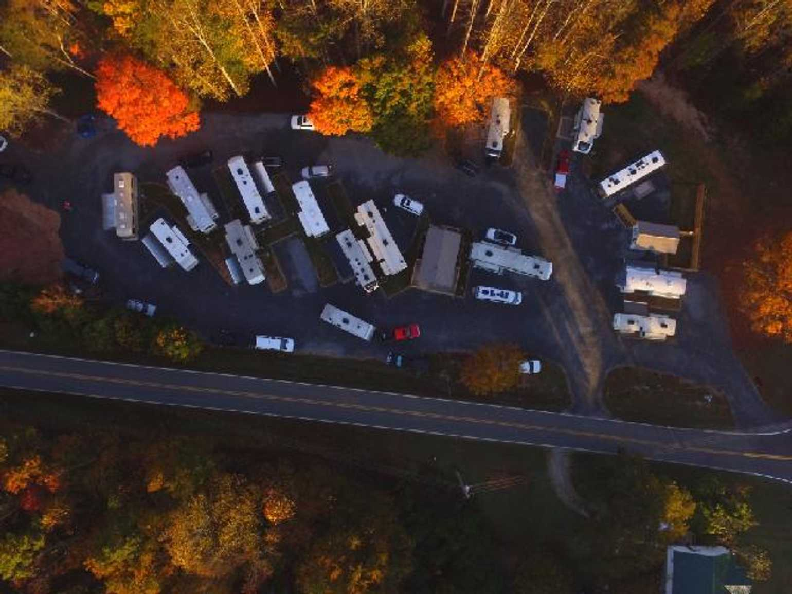 Ariel view of RVs parked at campground during fall