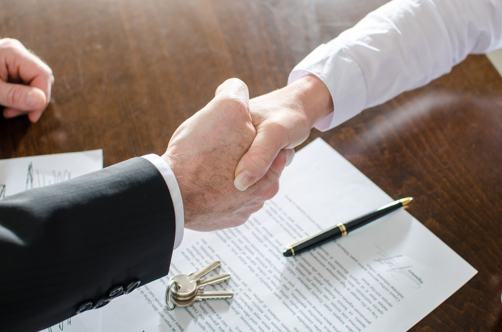 real estate investing for beginners: shaking hands