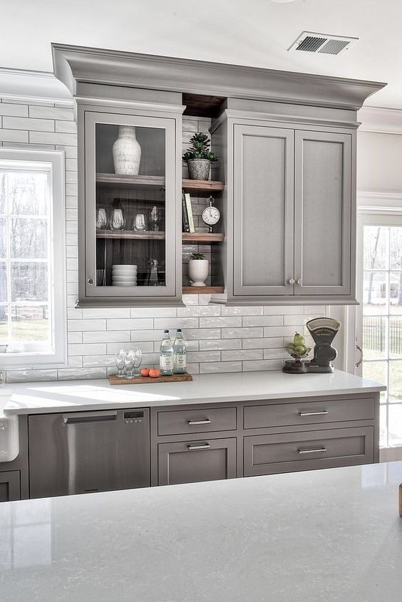 light gray cabinets with white countertops and white subway tile backsplash silver hardware