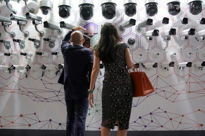People look at surveillance cameras at the annual Huawei Connect event in Shanghai, China, 18 September 2019 (Photo: Reuters/Aly Song).