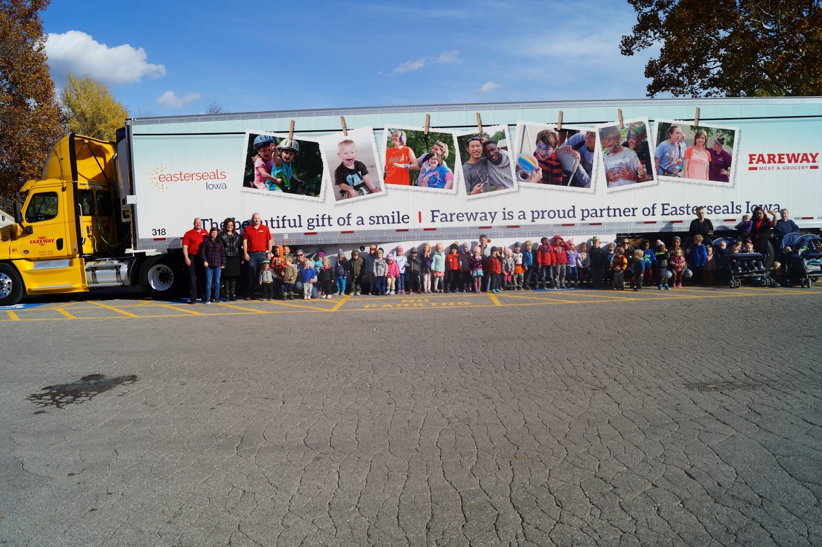 Image of a group of people standing in front of a Fareway truck.