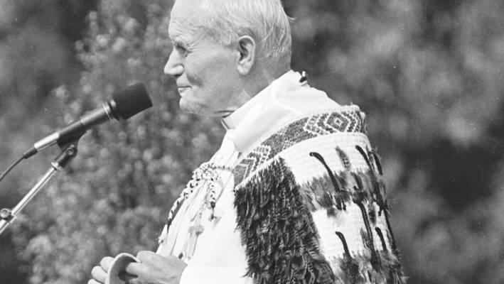 Pope John Paul II wearing a Maori feather cloak during his visit to the Auckland Domain.