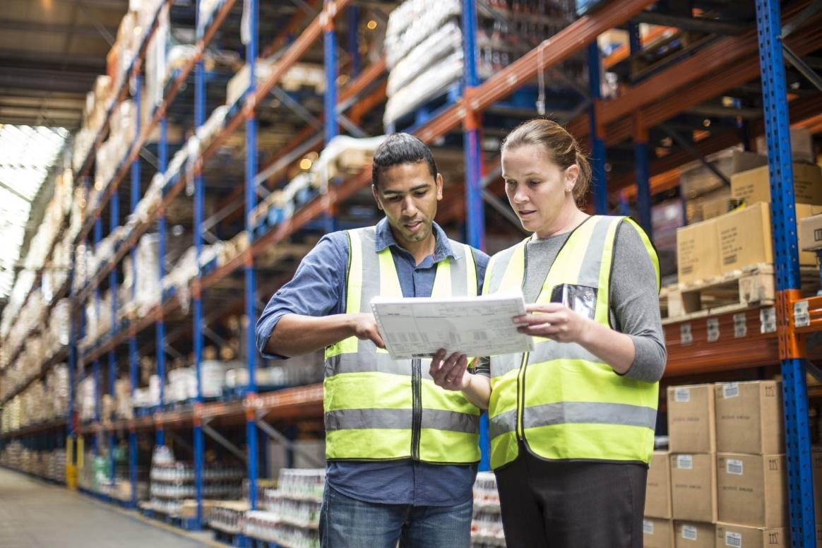 Two workers inside a warehouse