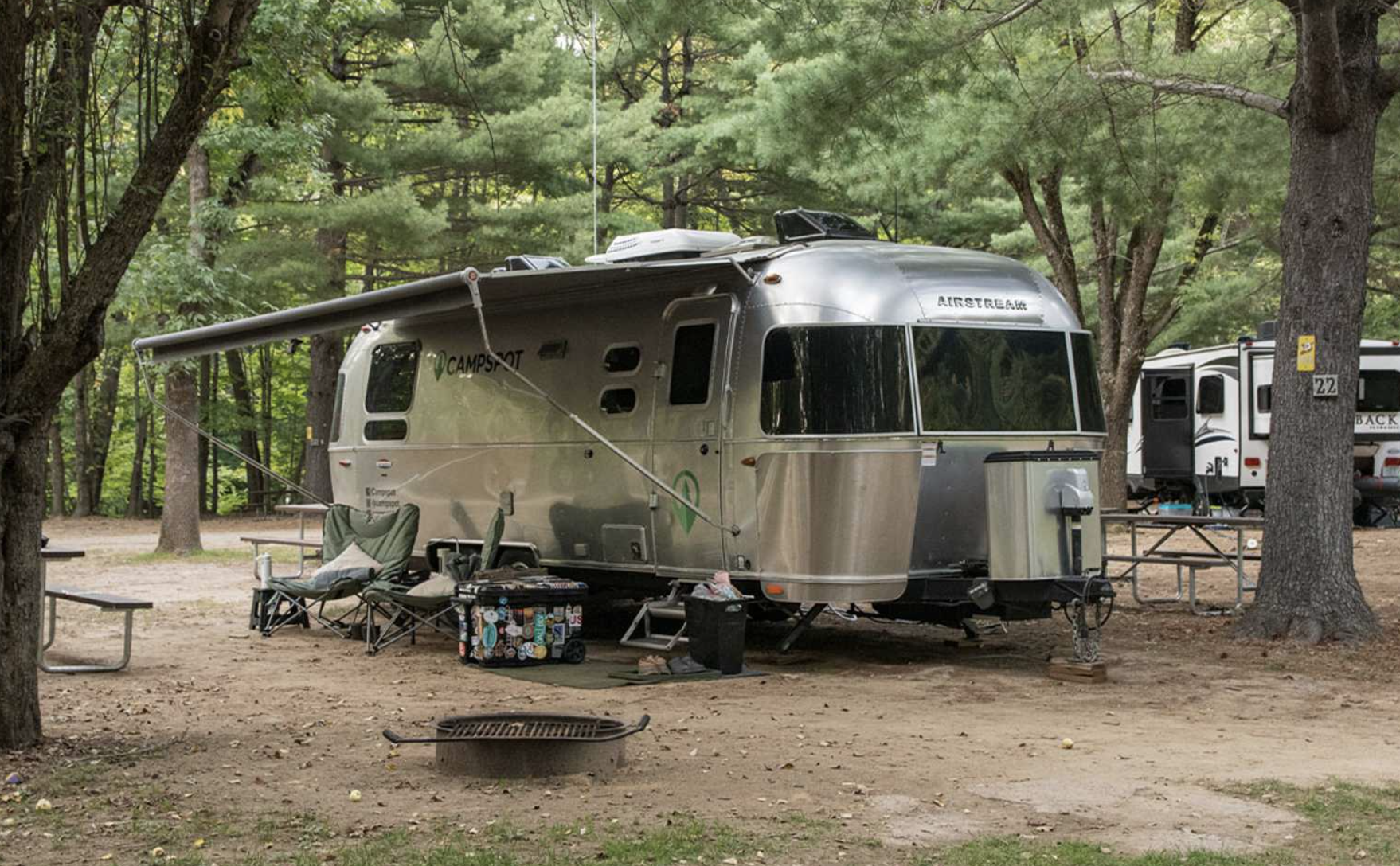 Airstream parked at Yogi Bear Jellystone campground in the woods