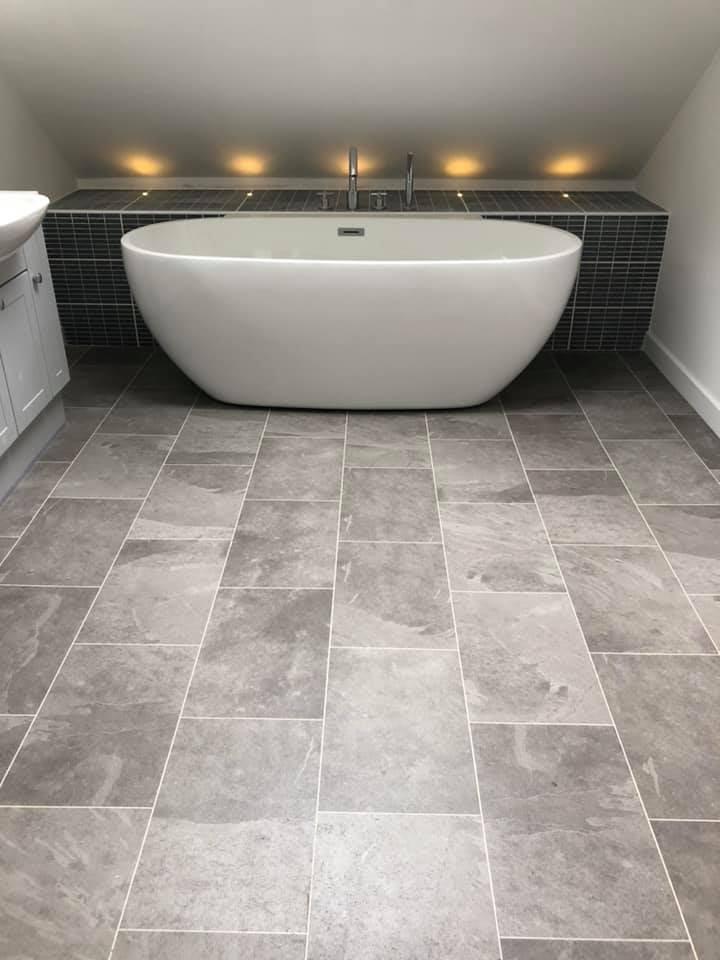 A bathtub in a bathroom  Description automatically generated with medium confidence