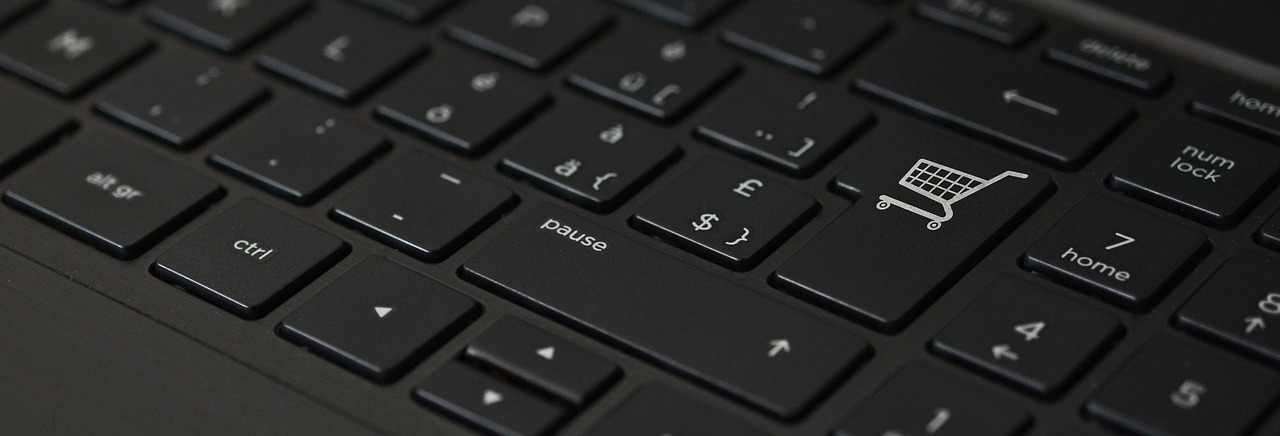 A keyboard with a shopping cart logo on the enter key micro-influencers