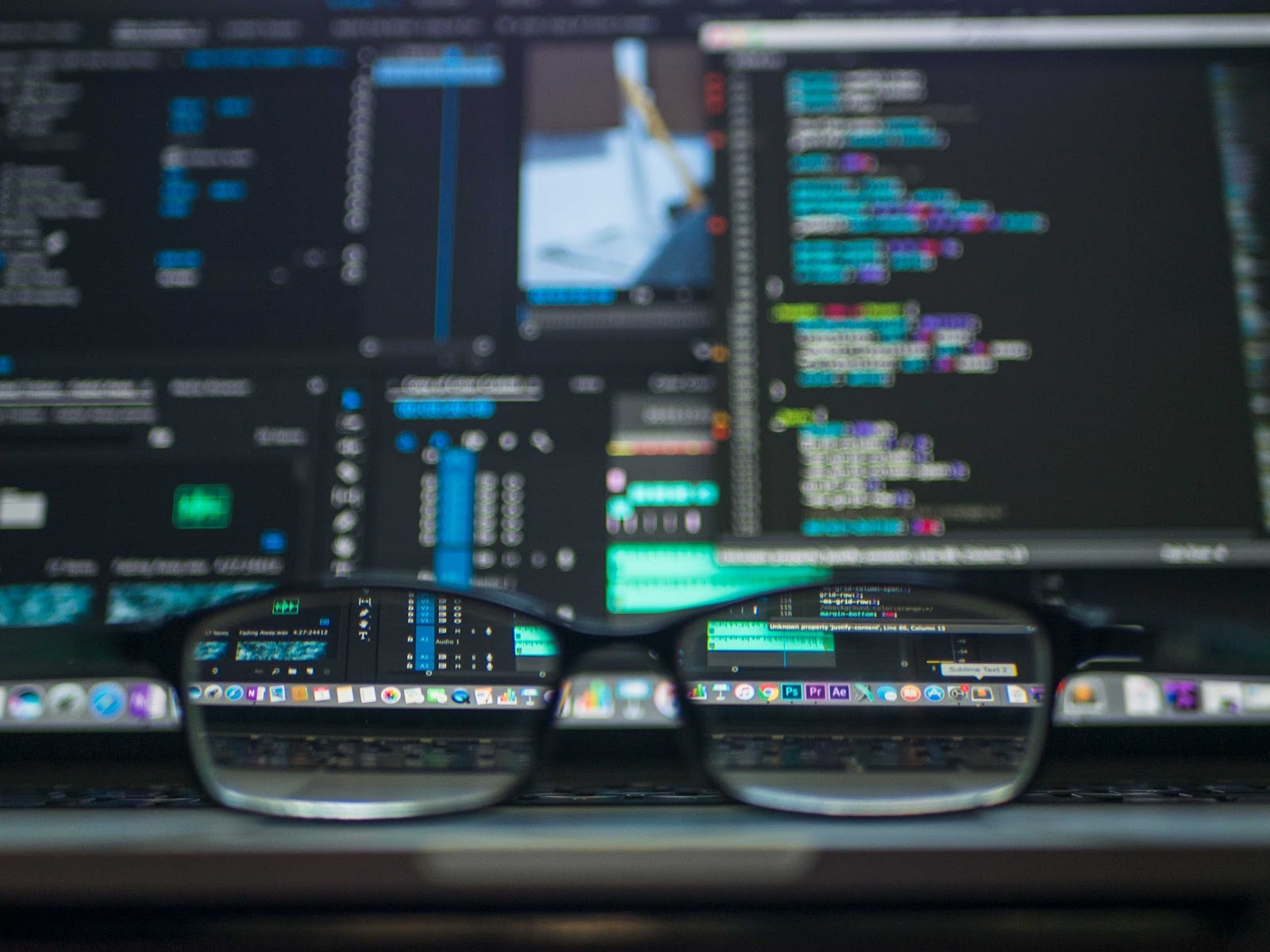 Code on a computer screen as seen through spectacles