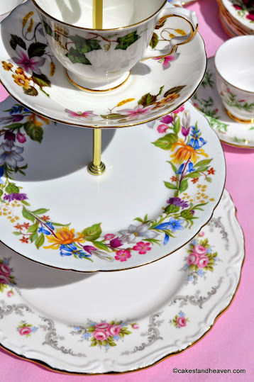 colourful floral mismatched three-tiered vintage cake stand with teacup top