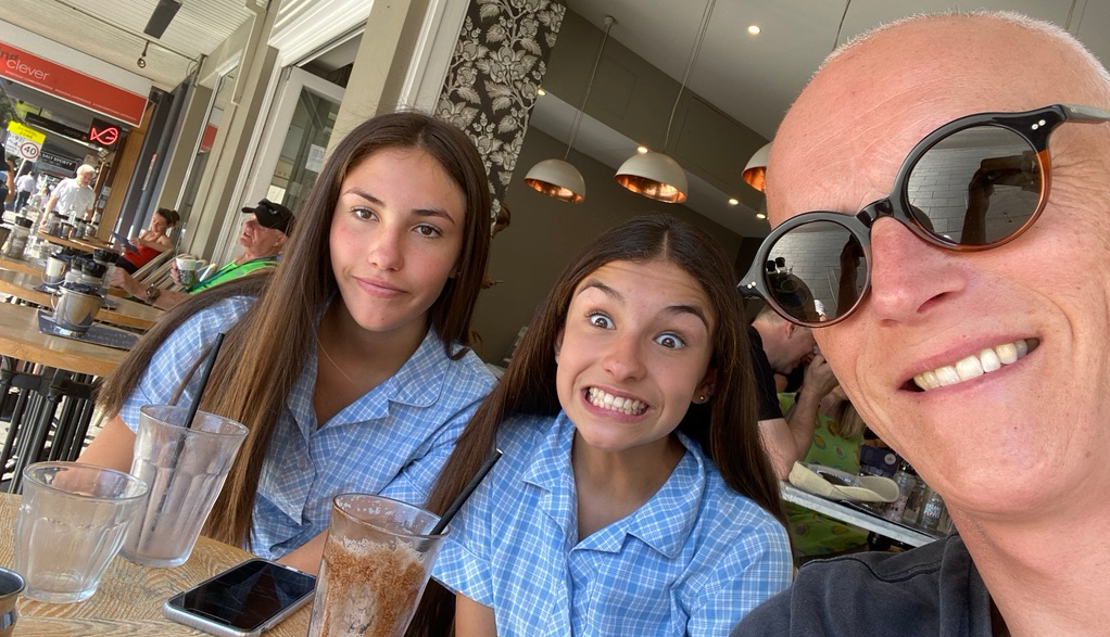Guy Ligertwood has breakfast with his daughters before school.