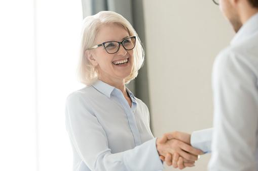 https://media.istockphoto.com/photos/happy-mature-businesswoman-handshaking-partner-client-trust-and-picture-id1135346338?b=1&k=6&m=1135346338&s=170667a&w=0&h=ozFMshQ7goqZ7Gz_Y_fbr6oAqLfNNZ12eom5FwfINWE=