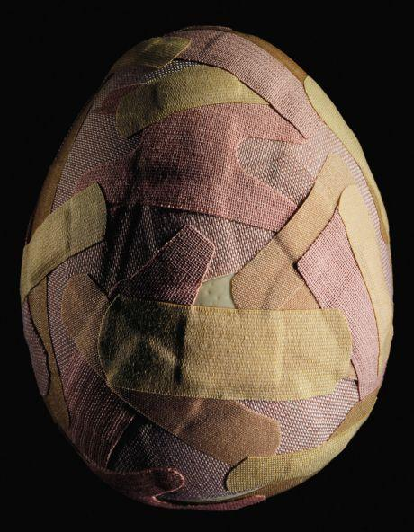 Egg covered in band-aids