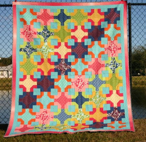 Colorful Quilt Hanging on School Fence