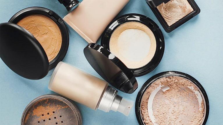 makeup and skincare shelf life-Set of decorative cosmetic. Foundations, facial powders. pastel colored. Blue background.