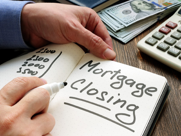 A man figuring out how much he owes in mortgage closing costs