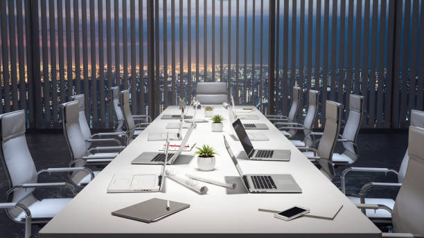 Empty meeting room and conference table with laptops, modern office 3d render Empty meeting room and conference table with laptops, modern office 3d render 3d illustration conference room stock pictures, royalty-free photos & images