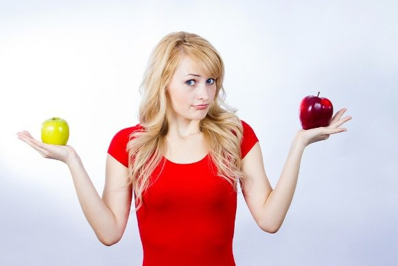 Woman Questioning Two Apples