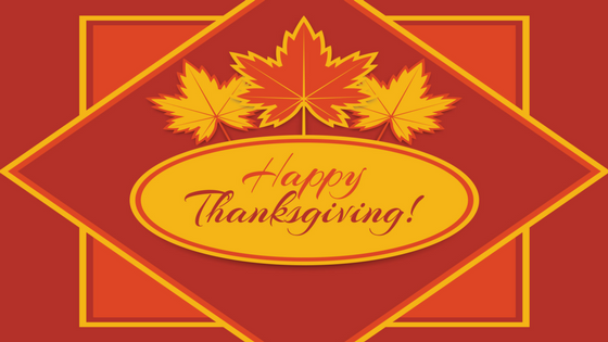 Happy Thanksgiving graphic in orange and yellow with leaves