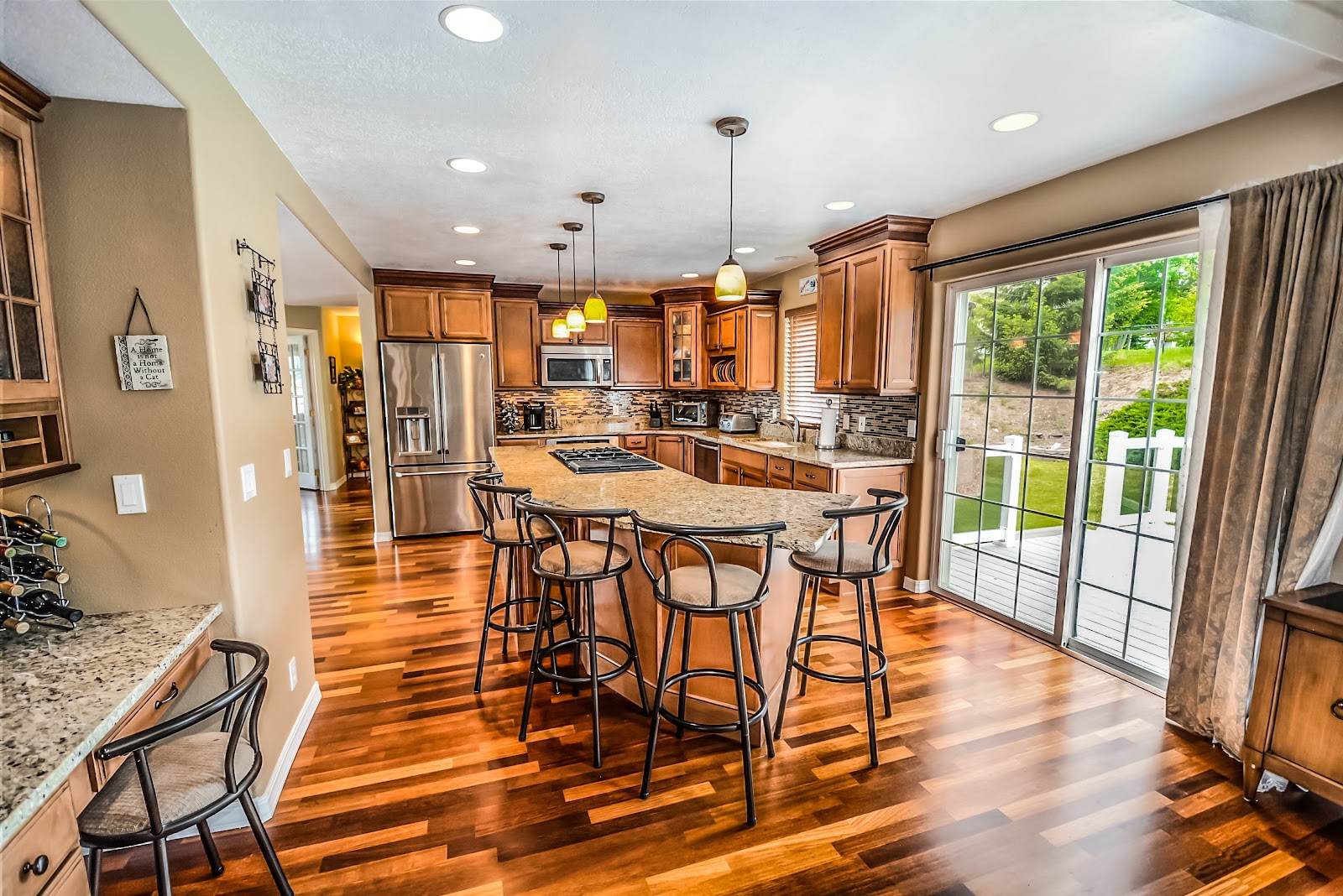 nice kitchen with hardwood floors and granite counter tops