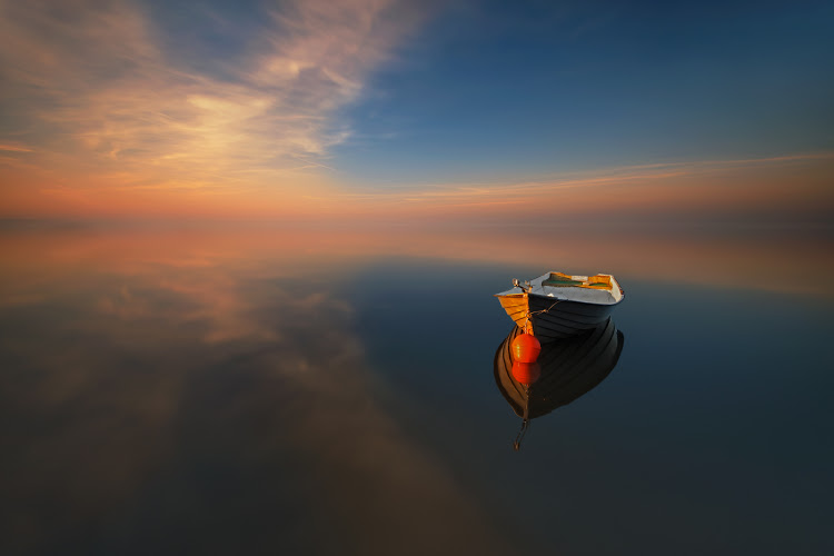 lonely-boat-in-the-middle-of-sea-water.jpg