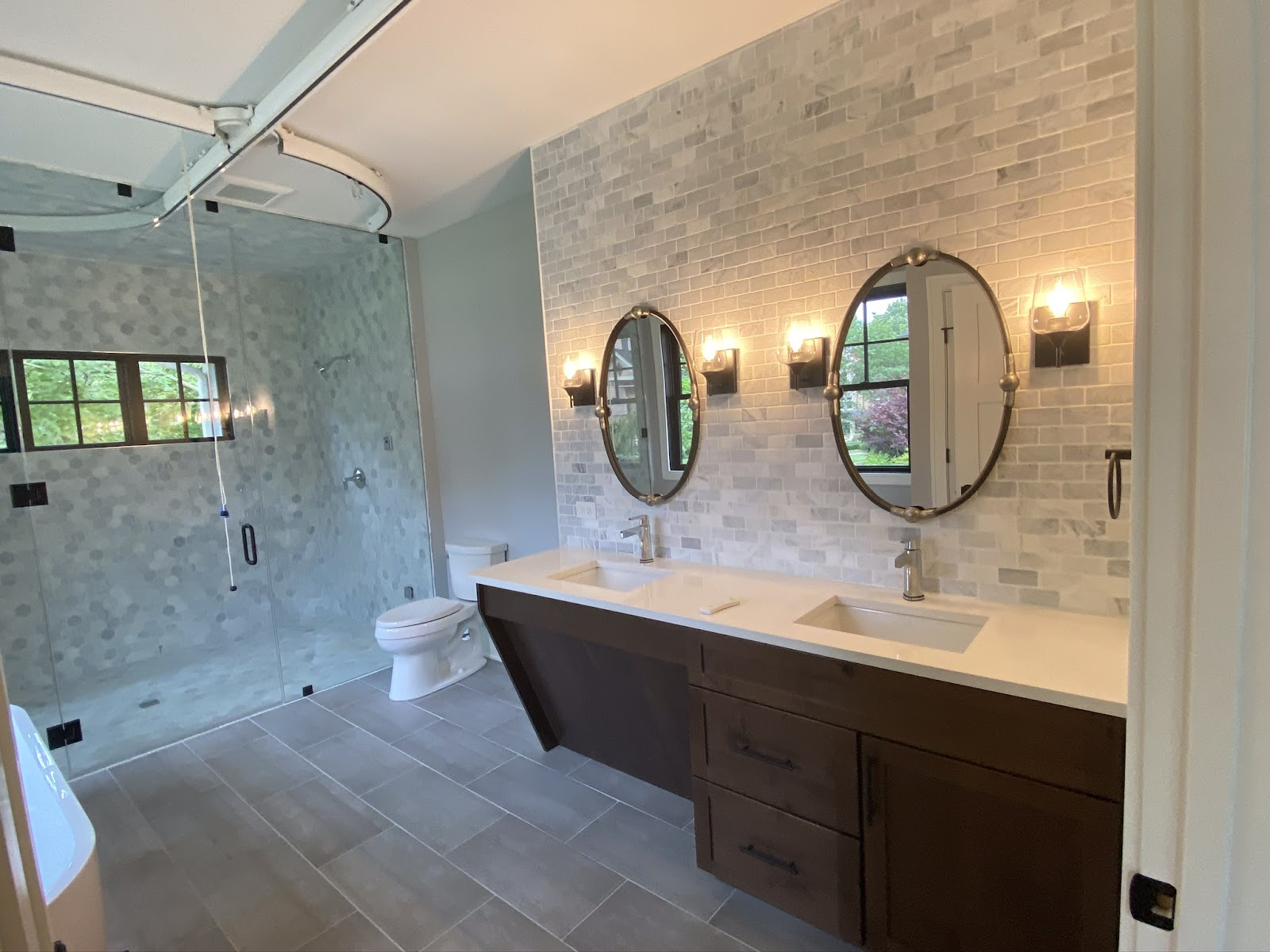 Barrier-free bath with pulley track and wheel chair accessible vanity