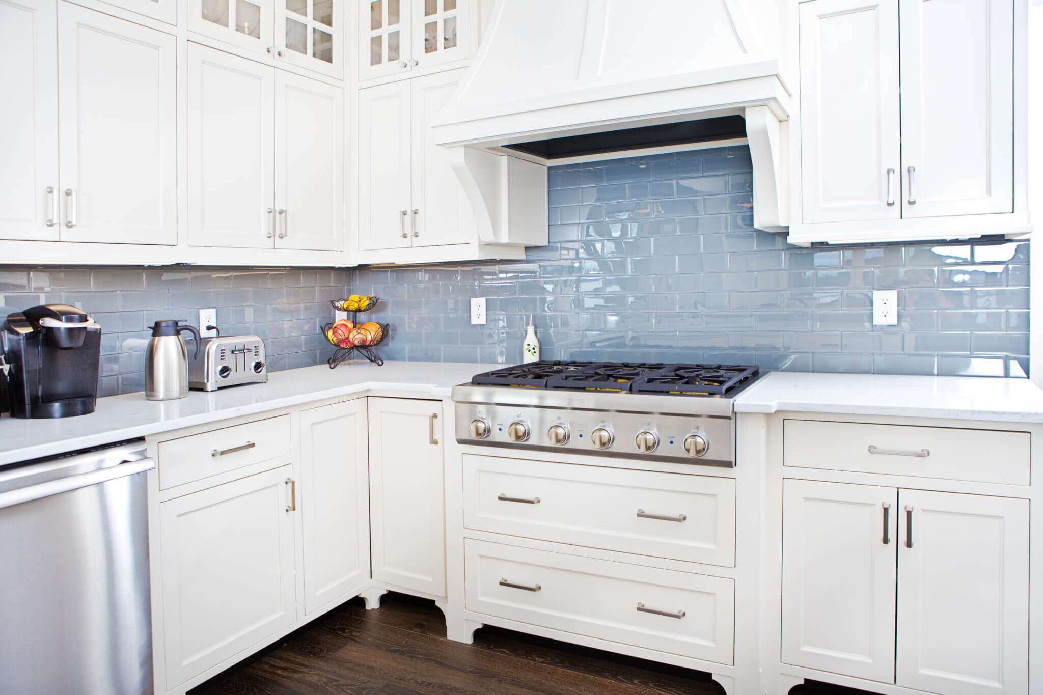 Kitchen with light blue subway tile backsplash