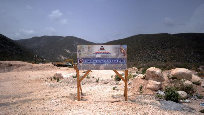 A sign advertises the future site of a center being built to receive Haitians deported from the Dominican Republic, close to the border in Fonds Parisiens, Haiti, on June 20, 2015