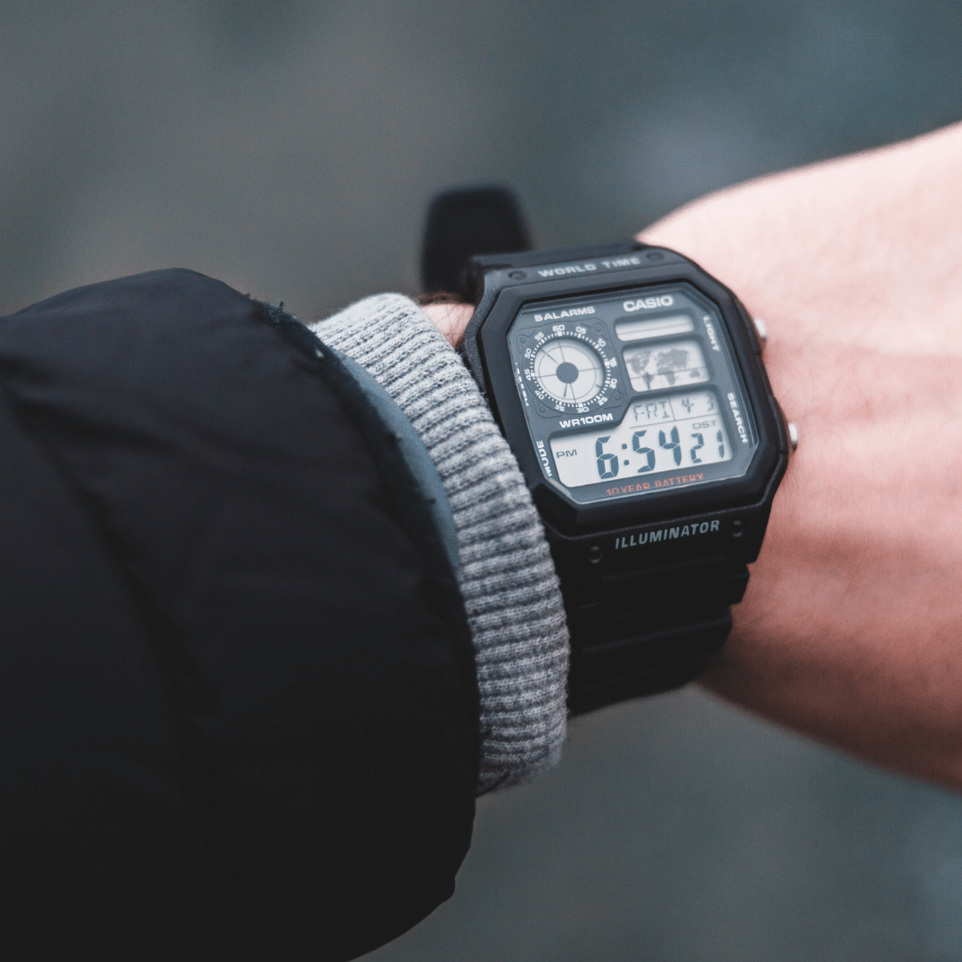 Photo of a digital watch on a person's wrist