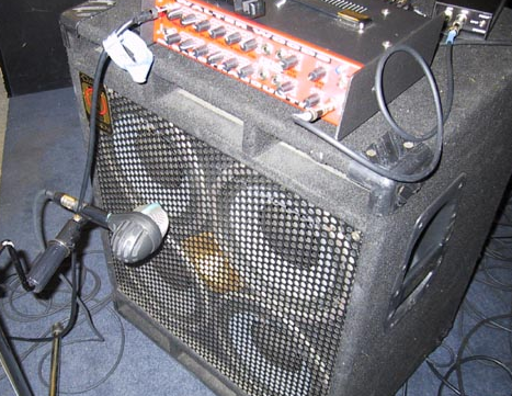 D112 in front of a bass guitar amp