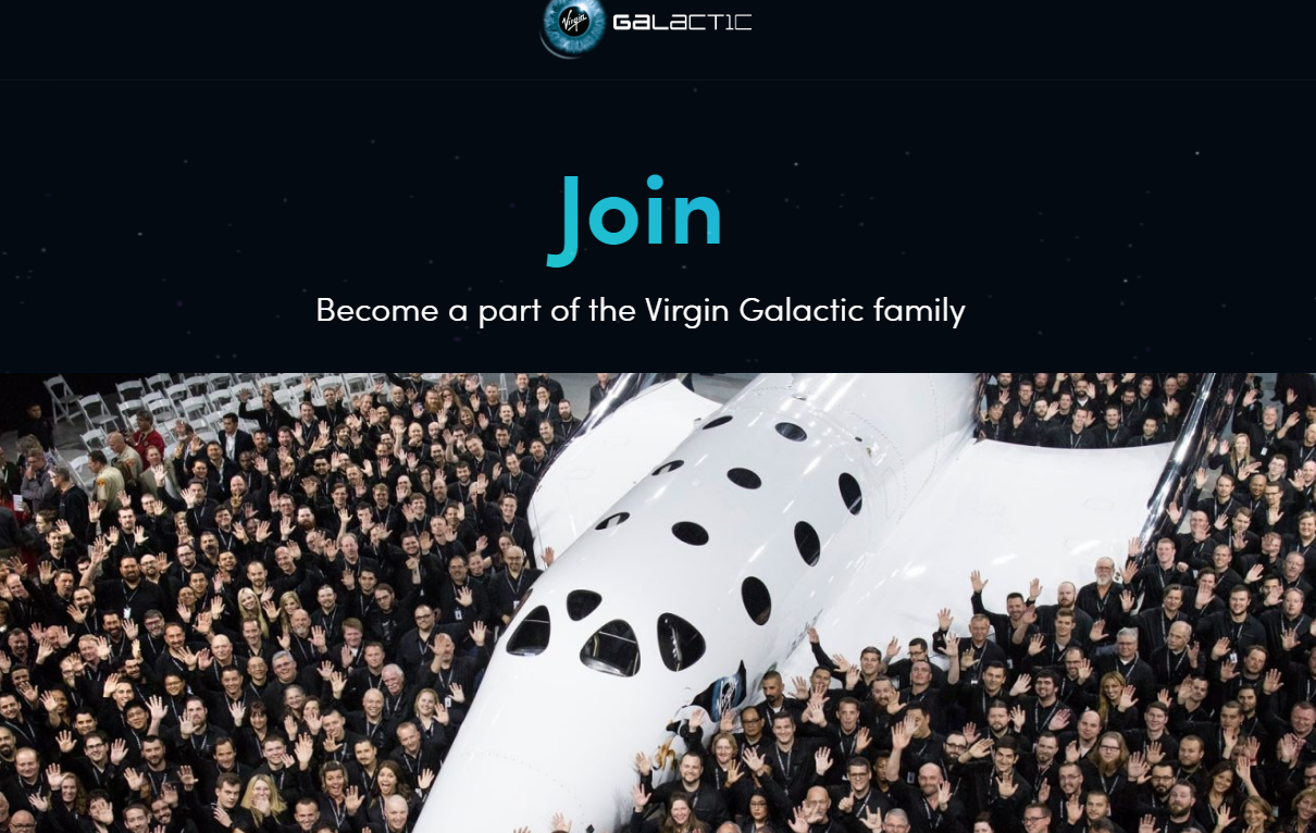 Virgin Galactic spaceship surrounded by a crowd of celebrating people