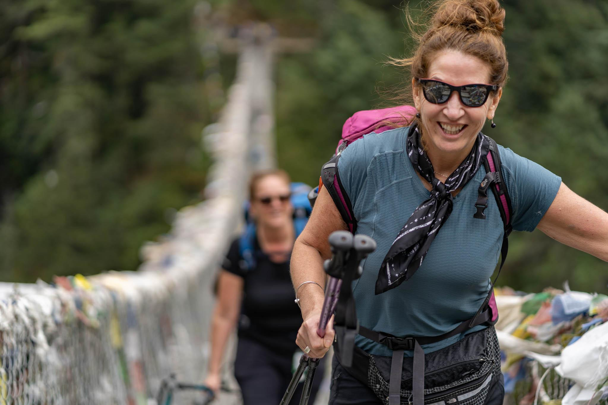 Two women on one of the suspension bridges on the trek