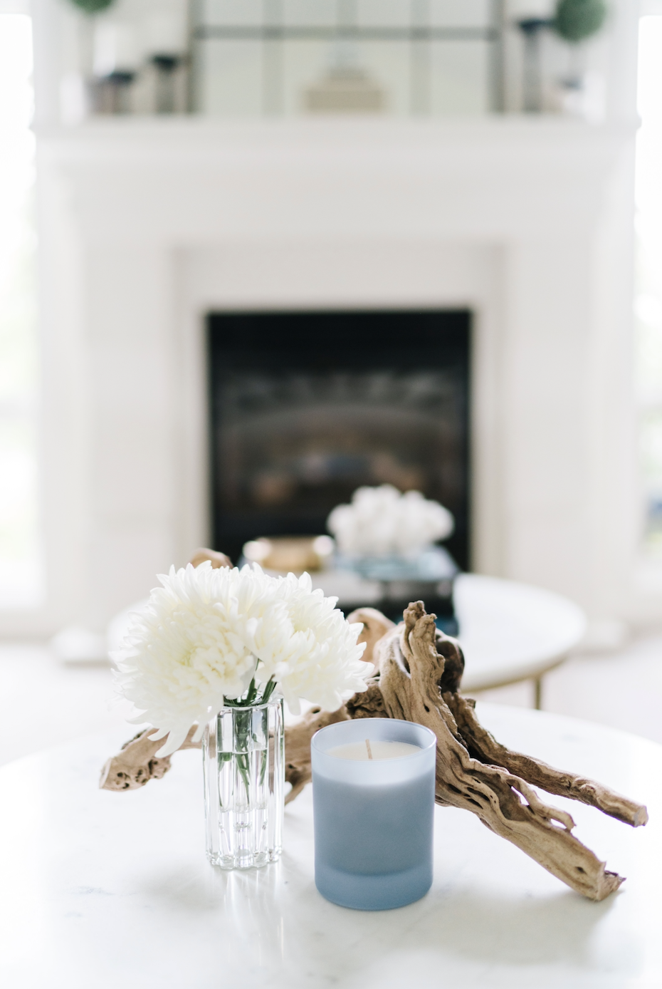vignette candle flowers driftwood fireplace light blue white calgary marble table