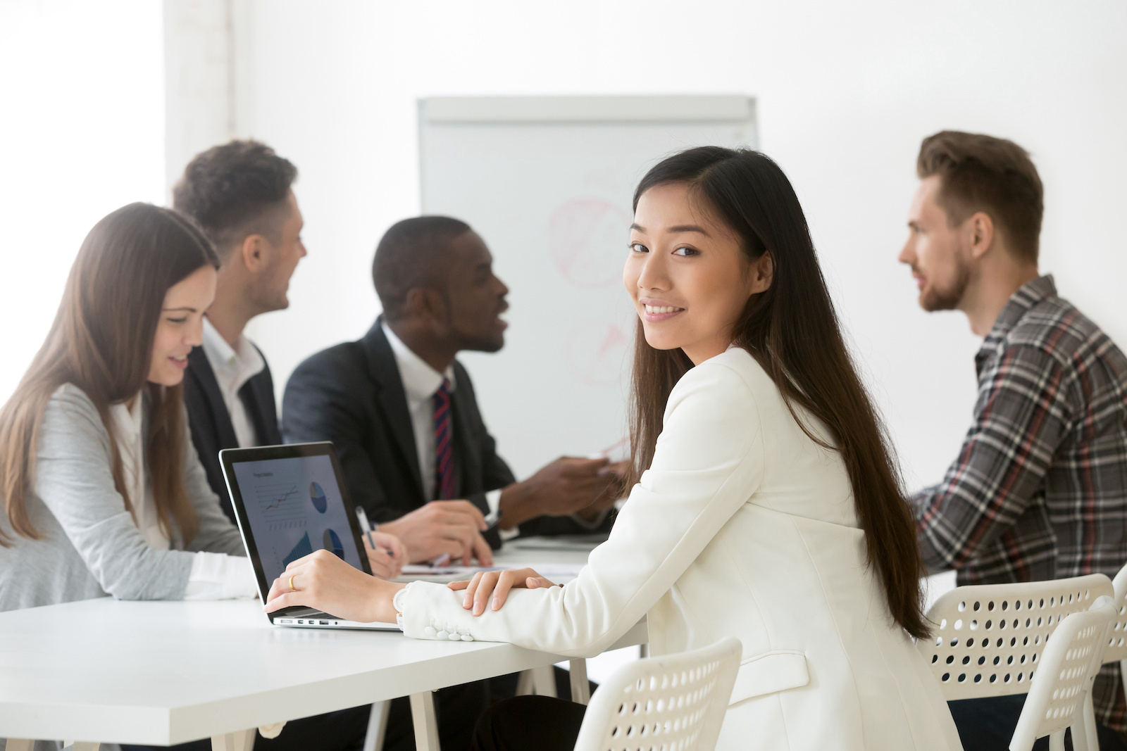 Intuit internship: woman smiling with a group of people